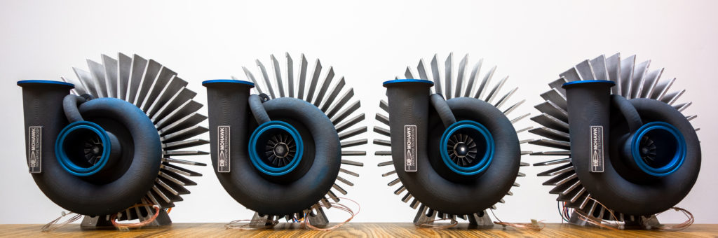 Picture of four Mohawk Innovative Technology, Inc. anode recycle blowers on a white background
